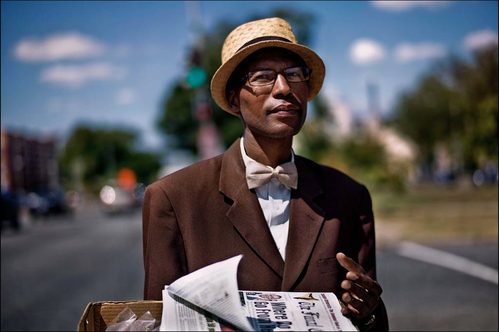 Copyright Sarah Lee - Pennsylvania Avenue Washington DC. Brother Burnell, who moved to the city two months ago. He finds it unfriendly but is staying optimistic. He sells copies of The Final Call [the Nation of Islam's newspaper] and bottles of insence on the street.